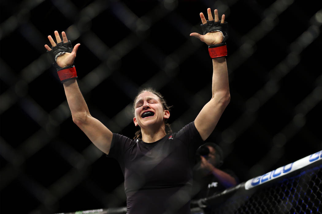 Roxanne Modafferi celebrates her second round technical knockout win against Barb Honchak in the women's flyweight bout during The Ultimate Fighter 27 Finale at the Palms casino-hotel in Las Vegas ...