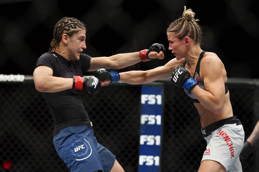 Roxanne Modafferi, left, battles Barb Honchak in the second round of the women's flyweight bout during The Ultimate Fighter 27 Finale at the Palms casino-hotel in Las Vegas, Friday, July 6, 2018. ...
