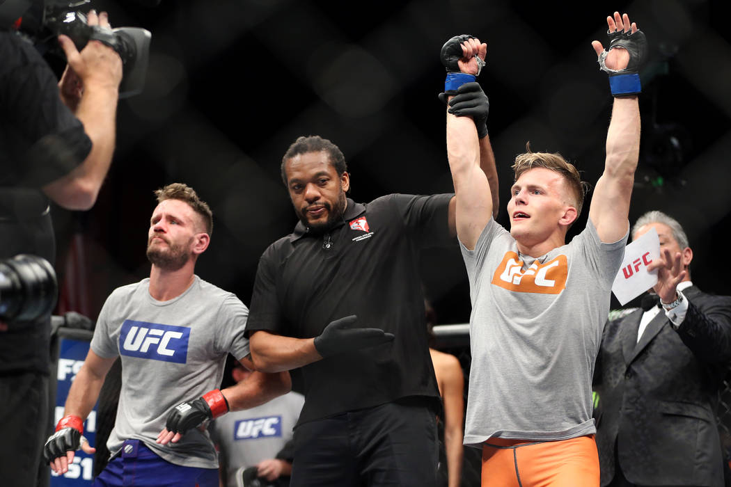 Brad Katona, right, is announced the winner by unanimous decision against Jay Cucciniello in The Ultimate Fighter Finale 27 featherweight final bout in Las Vegas, Friday, July 6, 2018. Erik Verduz ...
