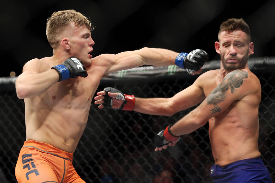 Brad Katona, left, connects a punch against Jay Cucciniello in The Ultimate Fighter Finale 27 featherweight final bout in Las Vegas, Friday, July 6, 2018. Katona won by unanimous decision. Erik Ve ...