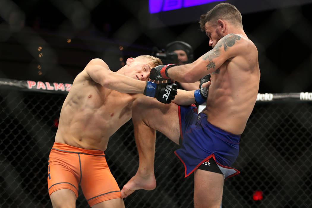 Brad Katona, left, takes a knee against Jay Cucciniello in The Ultimate Fighter Finale 27 featherweight final bout in Las Vegas, Friday, July 6, 2018. Katona won by unanimous decision. Erik Verduz ...