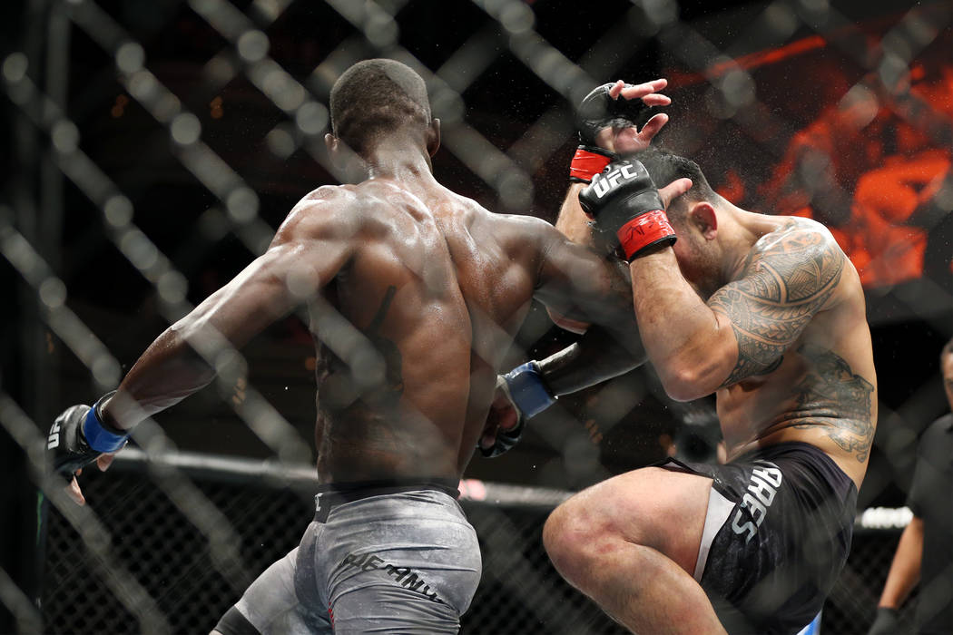 Israel Adesanya, left, connects an elbow against Brad Tavares in The Ultimate Fighter 27 Finale middleweight main event bout at the Palms casino-hotel in Las Vegas, Friday, July 6, 2018. Erik Verd ...