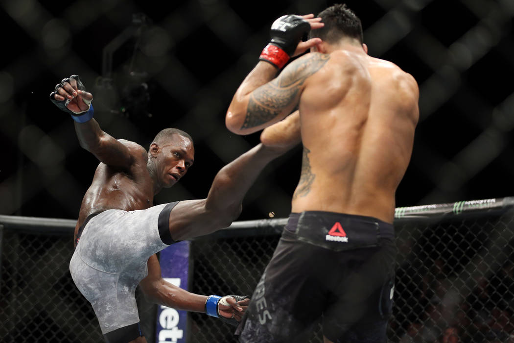 Israel Adesanya, left, kicks Brad Tavares in The Ultimate Fighter 27 Finale middleweight main event bout at the Palms casino-hotel in Las Vegas, Friday, July 6, 2018. Erik Verduzco Las Vegas Revie ...