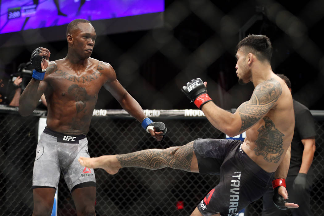 Brad Tavares, right, kicks Israel Adesanya in The Ultimate Fighter 27 Finale middleweight main event bout at the Palms casino-hotel in Las Vegas, Friday, July 6, 2018. Erik Verduzco Las Vegas Revi ...