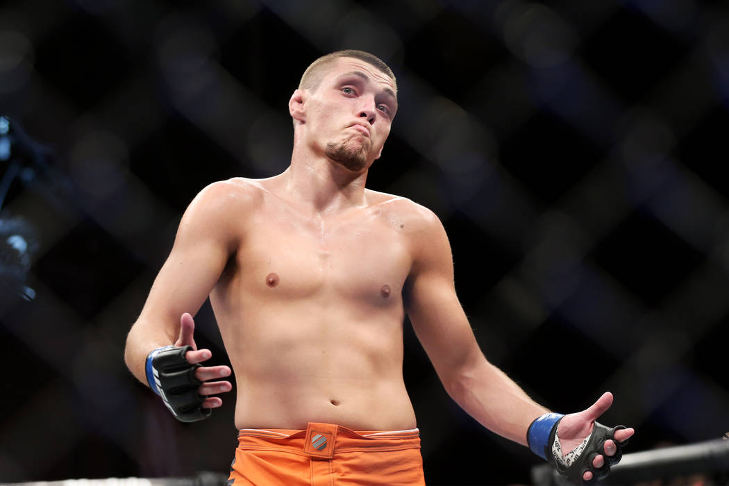 Joe Giannetti reacts after round two against Michael Trizano in The Ultimate Fighter Finale 27 lightweight final bout in Las Vegas, Friday, July 6, 2018. Trizano won by unanimous decision. Erik Ve ...