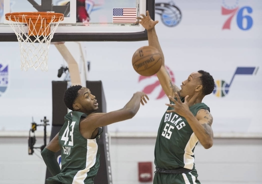 Bucks center Brandon McCoy (43) and guard Tim Quarterman (55) reach for a loose ball during Milwaukee's game with the Detroit Pistons during NBA Summer League on Friday, July 6, 2018, at Cox Pavil ...