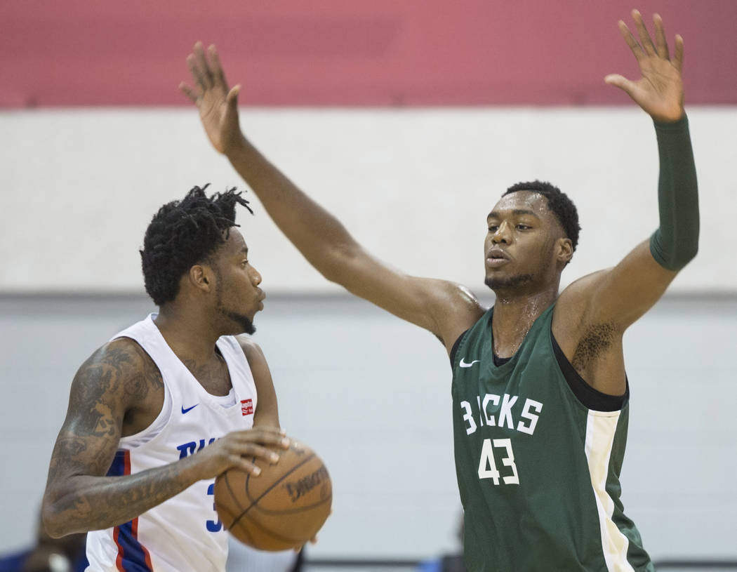 Milwaukee Bucks center Brandon McCoy (43) guards Detroit Pistons guard Eric Griffin (39) during NBA Summer League on Friday, July 6, 2018, at Cox Pavilion, in Las Vegas. Benjamin Hager Las Vegas R ...