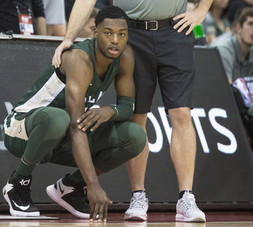 Bucks center Brandon McCoy, left, waits to check in during Milwaukee's game with the Detroit Pistons during NBA Summer League on Friday, July 6, 2018, at Cox Pavilion, in Las Vegas. Benjamin Hage ...