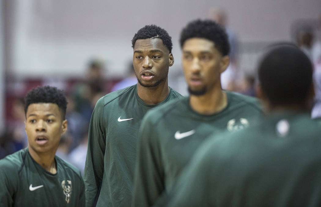 Bucks center Brandon McCoy, second from left, warms up before the start of Milwaukee's game with the Detroit Pistons during NBA Summer League on Friday, July 6, 2018, at Cox Pavilion, in Las Vegas ...