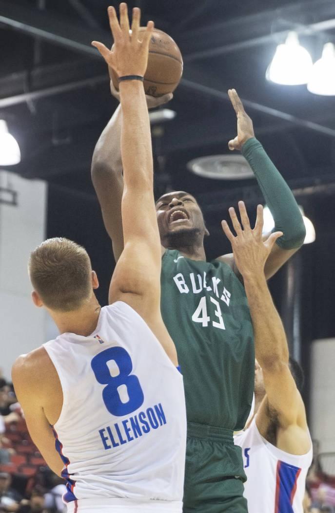 Milwaukee Bucks center Brandon McCoy (43) shoots over Detroit Pistons forward Henry Ellenson (8) during NBA Summer League on Friday, July 6, 2018, at Cox Pavilion, in Las Vegas. Benjamin Hager Las ...