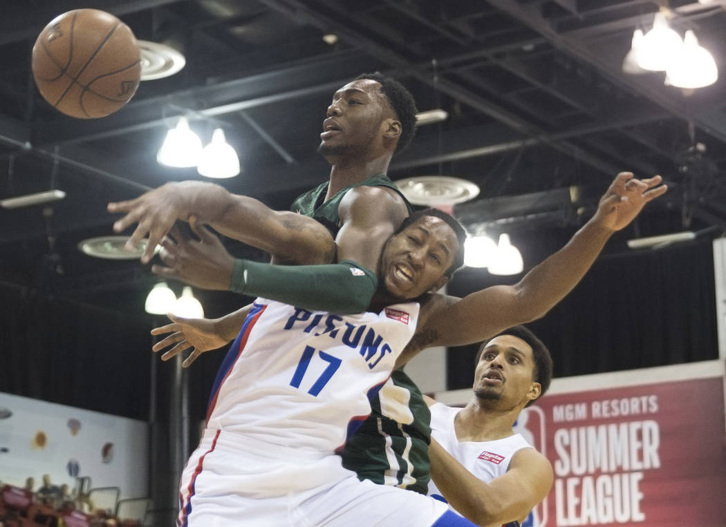 Milwaukee Bucks center Brandon McCoy (43) fights for a rebound with Detroit Pistons guard Kenneth Smith (17) during NBA Summer League on Friday, July 6, 2018, at Cox Pavilion, in Las Vegas. Benjam ...