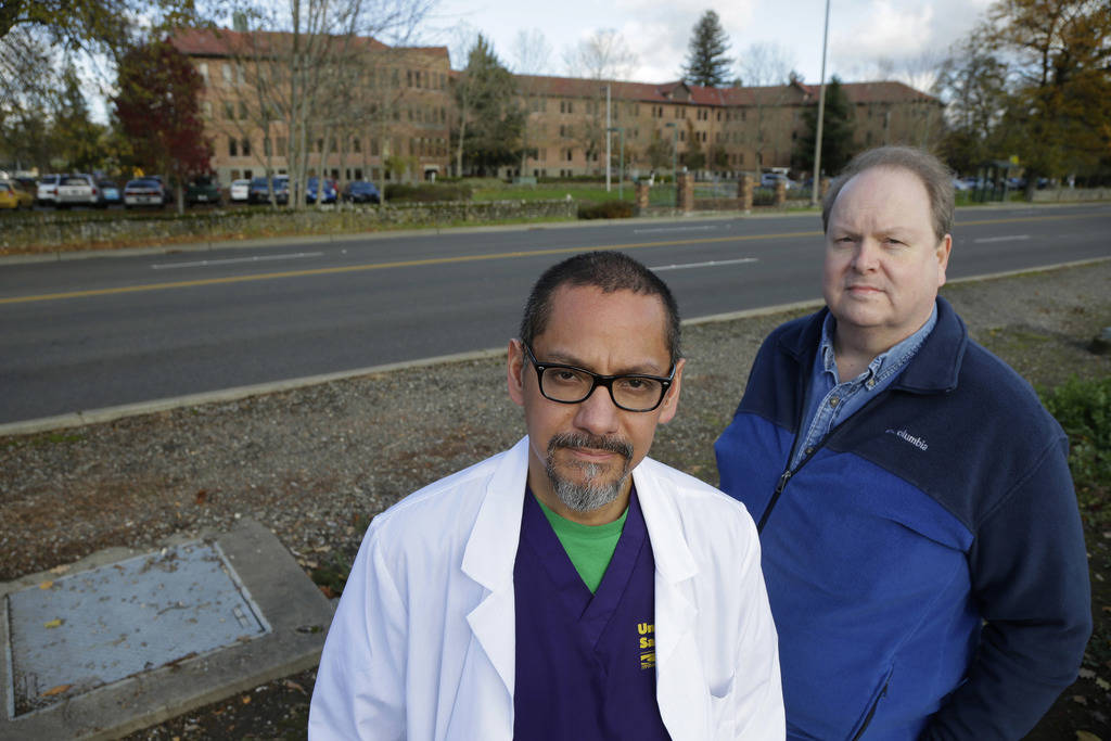 Dr. Joseph Wainer, left, a psychiatrist at Western State Hospital, and Paul Vilja, right, a nursing supervisor, pose for a photo near the facility in Lakewood, Wash., in 2015. (AP Photo/Ted S. War ...