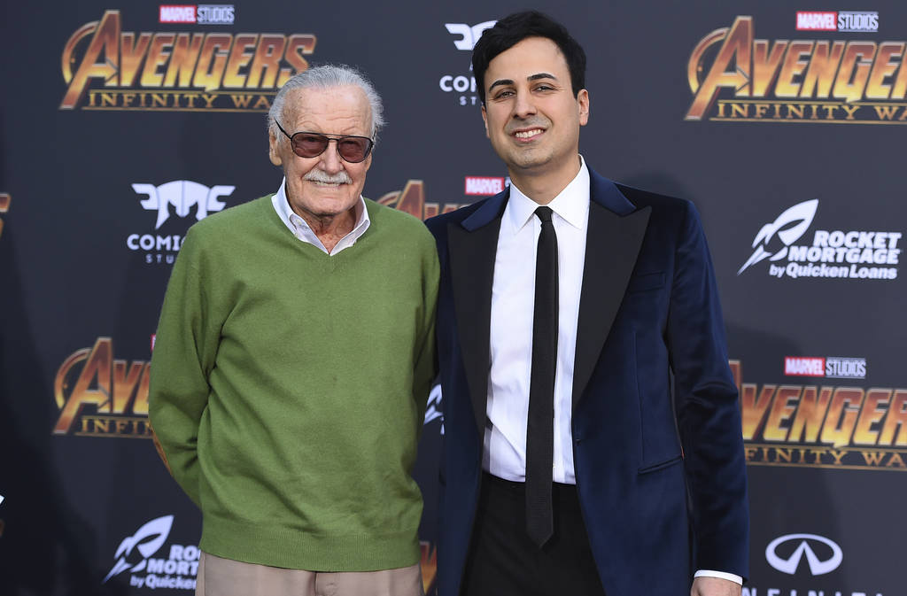 "Stan Lee, left, and Keya Morgan arrive at the world premiere of ""Avengers: Infinity War"" in Los Angeles in April 2018. (Photo by Jordan Strauss/Invision/AP, File)"