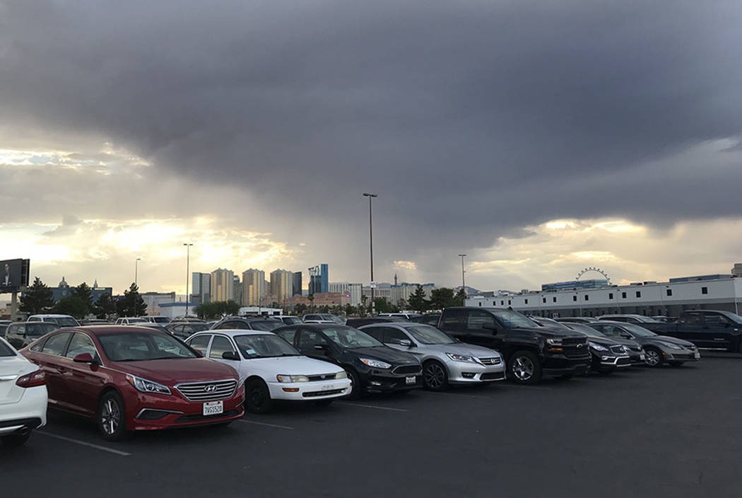 A thunderstorm is seen from the Thomas & Mack parking lot on the UNLV campus Saturday, July 7, 2018. (Elaine Wilson/Las Vegas Review-Journal)