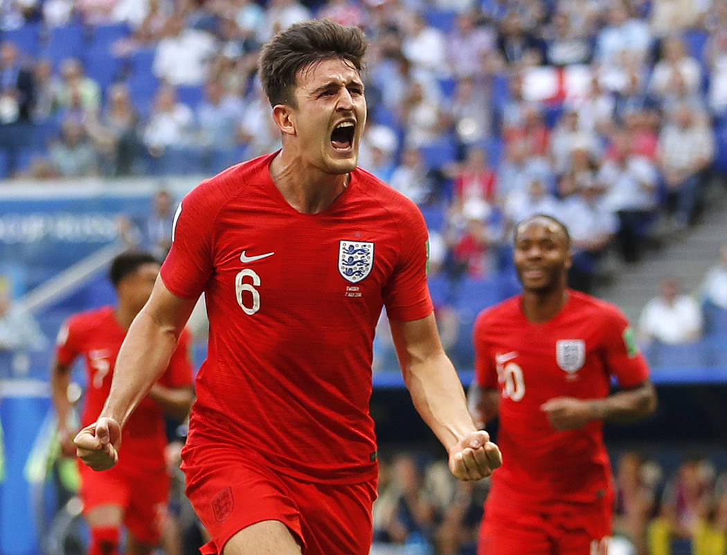 England's Harry Maguire celebrates after scoring his side opening goal during the quarterfinal match between Sweden and England at the 2018 soccer World Cup in the Samara Arena, in Samara, Russia, ...