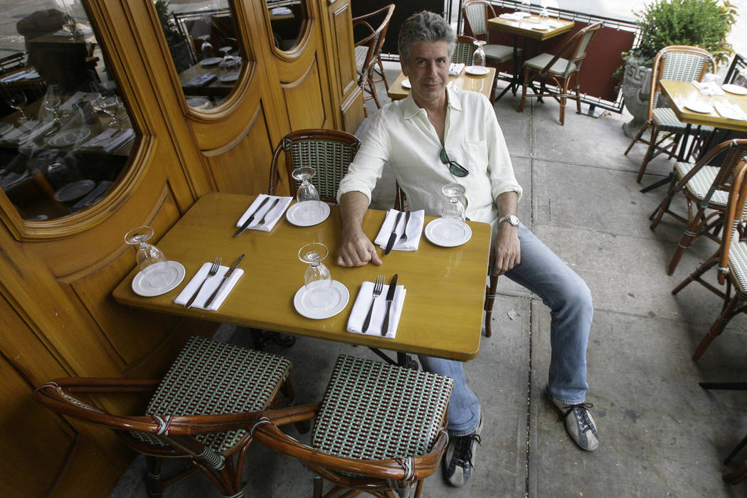 "Anthony Bourdain, host of theTravel Channel's ""No Reservations,"" poses in a New York restaurant on Aug. 8, 2007. (AP Photo/Mary Altaffer, File)"