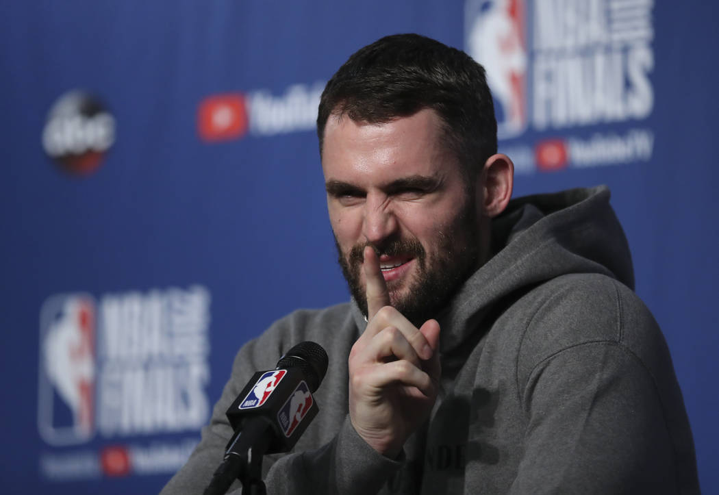 Cleveland Cavaliers center Kevin Love (0) takes questions at a press conference after the basketball team's practiced during the NBA Finals, Thursday, June 7, 2018, in Cleveland. The Warriors lead ...