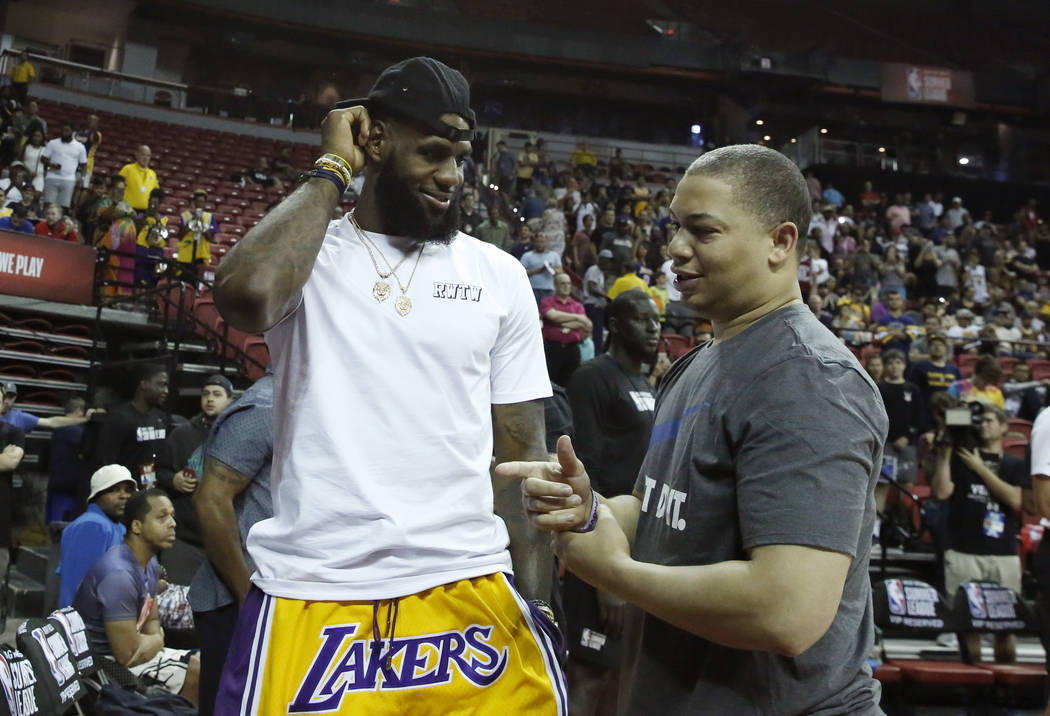 The Los Angeles Lakers' LeBron James chats with Cleveland Cavaliers coach Tyronn Lue at the Thomas & Mack Center during an NBA Summer League basketball game on Sunday, July 15, 2018, in Las V ...