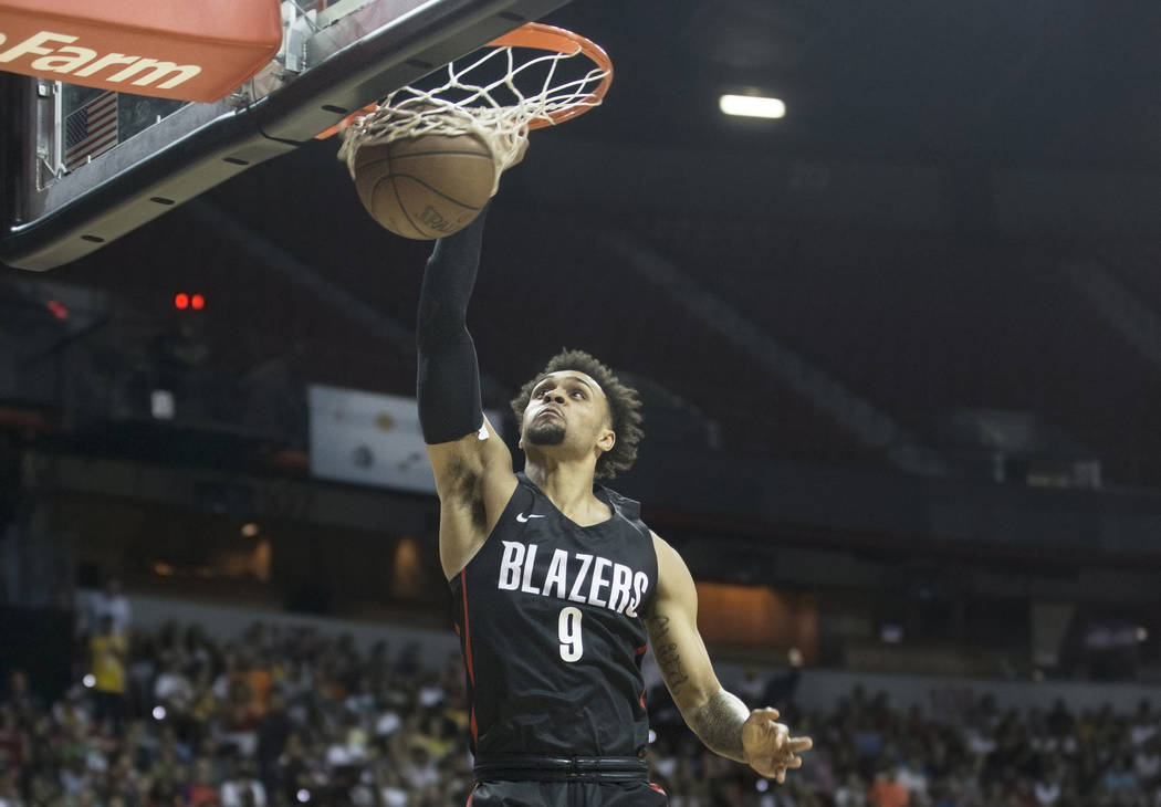 Trail Blazers guard Gary Trent Jr. (9) converts a fast break dunk in the second quarter during Portland's NBA Summer League finals game with the Los Angeles Lakers on Tuesday, July 17, 2018, at th ...