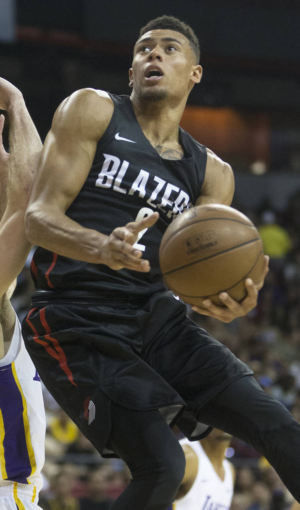 Portland Trail Blazers guard Wade Baldwin IV (2) drives past Los Angeles Lakers forward Sviatoslav Mykhailiuk (10) in the second quarter during the NBA Summer League finals on Tuesday, July 17, 20 ...