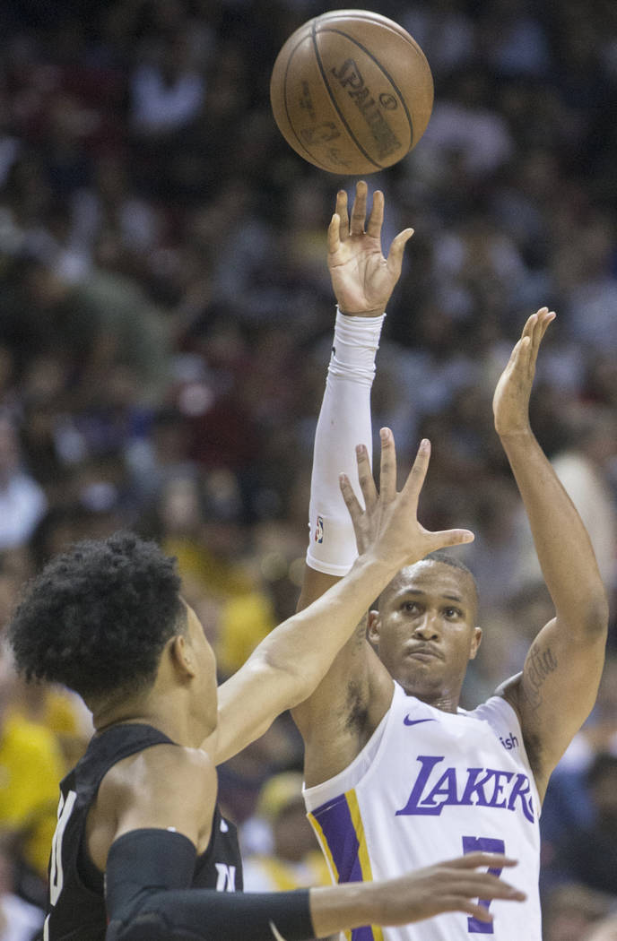 Los Angeles Lakers guard Demarcus Holland (7) shoots over Portland Trail Blazers guard Anfernee Simons (24) in the fourth quarter during the NBA Summer League finals on Tuesday, July 17, 2018, at ...