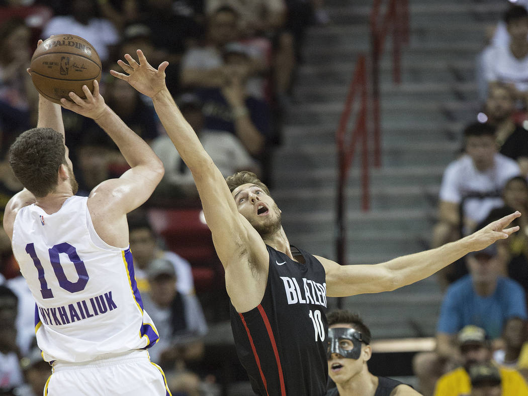 Portland Trail Blazers forward Jake Layman (10) defends Los Angeles Lakers forward Sviatoslav Mykhailiuk (10) in the first quarter during the NBA Summer League finals on Tuesday, July 17, 2018, at ...