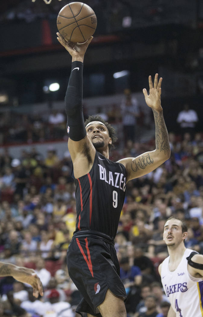 Portland Trail Blazers guard Gary Trent Jr. (9) drives past Los Angeles Lakers guard Alex Caruso (4) in the fourth quarter during the NBA Summer League finals on Tuesday, July 17, 2018, at the Tho ...