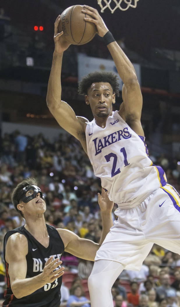 Los Angeles Lakers forward Johnathan Williams (21) grabs a rebound over Portland Trail Blazers center Zach Collins (33) in the second quarter during the NBA Summer League finals on Tuesday, July 1 ...