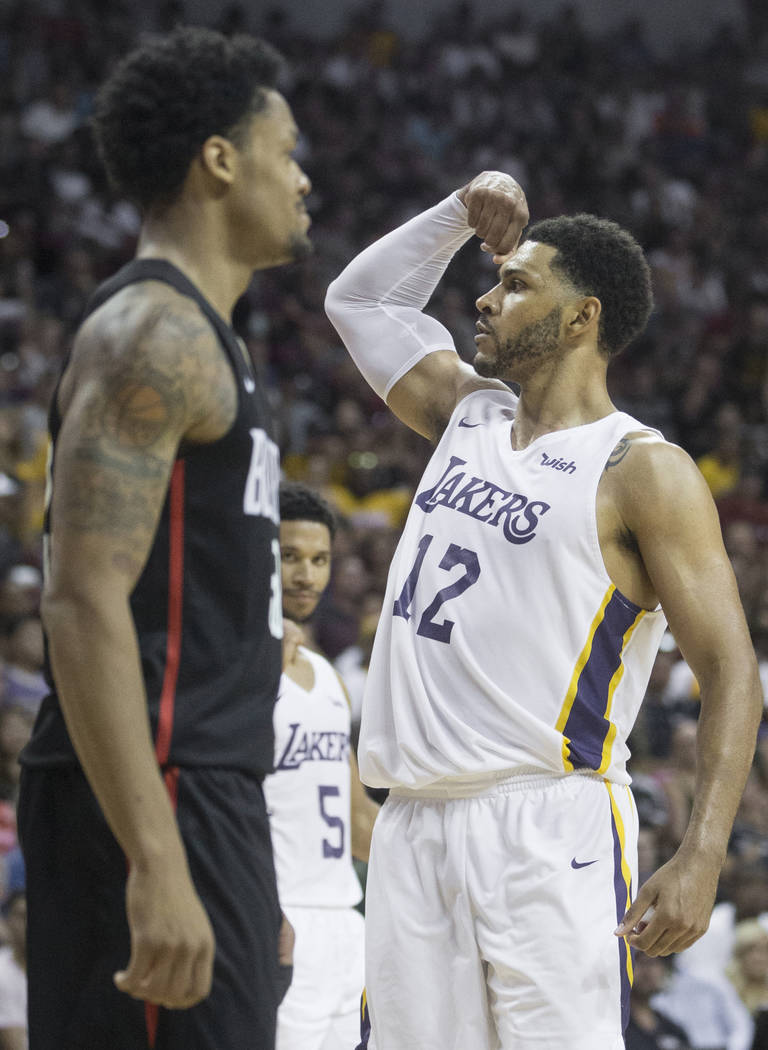 Lakers forward Jeff Ayres (12) flexes after getting fouled on the way to the basket during Los Angeles' Summer League finals game with the Portland Trail Blazers on Tuesday, July 17, 2018, at the ...