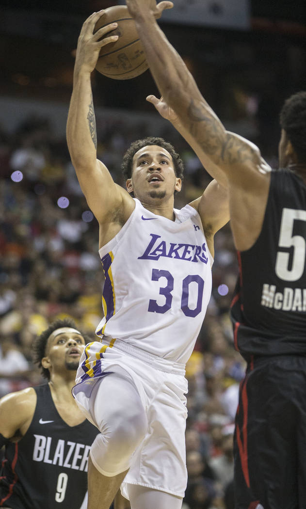 Los Angeles Lakers guard Jeffrey Carrol (30) drives past Portland Trail Blazers defenders Gary Trent Jr. (9) and K.J. McDaniels (59) in the third quarter during the NBA Summer League finals on Tue ...