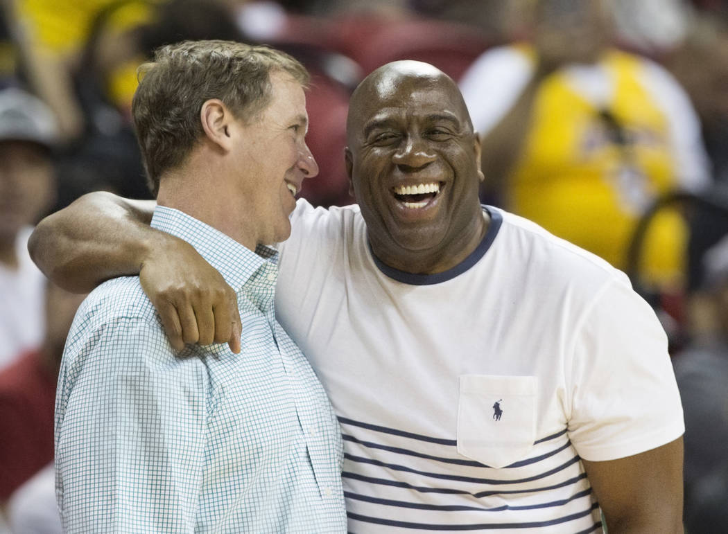 Lakers general manager Magic Johnson, right, jokes around before the start of Los Angeles' NBA Summer League finals game with the Portland Trail Blazers on Tuesday, July 17, 2018, at the Thomas &a ...