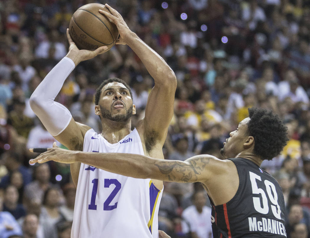 Los Angeles Lakers forward Jeff Ayres (12) shoots over Portland Trail Blazers guard K.J. McDaniels (59) in the third quarter during the NBA Summer League finals on Tuesday, July 17, 2018, at the T ...
