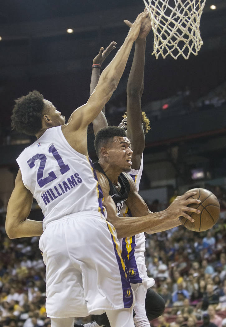 Portland Trail Blazers guard Wade Baldwin IV (2) drives past Los Angeles Lakers defenders Johnathan Williams (21) and Isaac Bonga (17) in the fourth quarter during the NBA Summer League finals on ...
