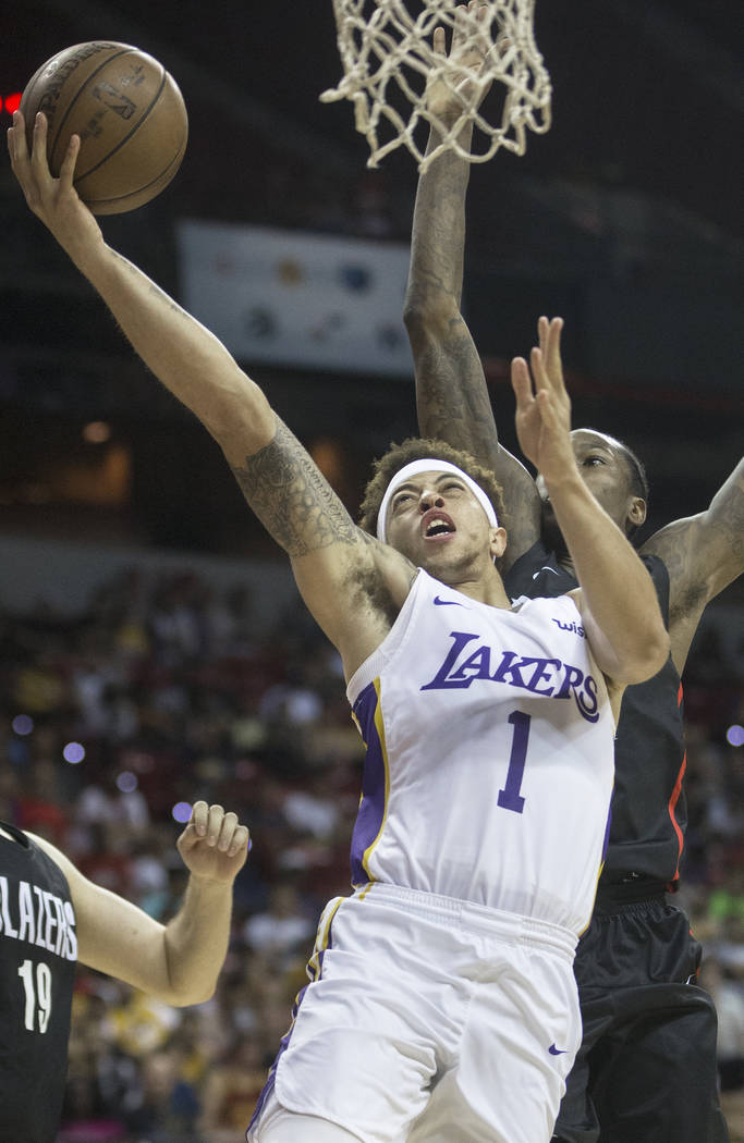 Los Angeles Lakers guard Stephaun Branch (1) drives past Portland Trail Blazers guard Archie Goodwin (70) in the fourth quarter during the NBA Summer League finals on Tuesday, July 17, 2018, at th ...