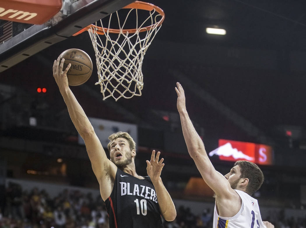 Portland Trail Blazers forward Jake Layman (10) drives past Los Angeles Lakers forward Sviatoslav Mykhailiuk (10) in the first quarter during the NBA Summer League finals on Tuesday, July 17, 2018 ...