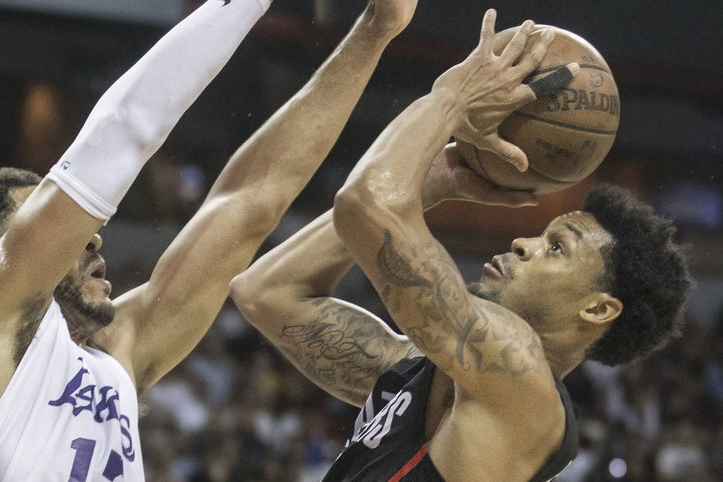 Portland Trail Blazers guard K.J. McDaniels (59) drives past Los Angeles Lakers forward Jeff Ayres (12) in the second quarter during the NBA Summer League finals on Tuesday, July 17, 2018, at the ...