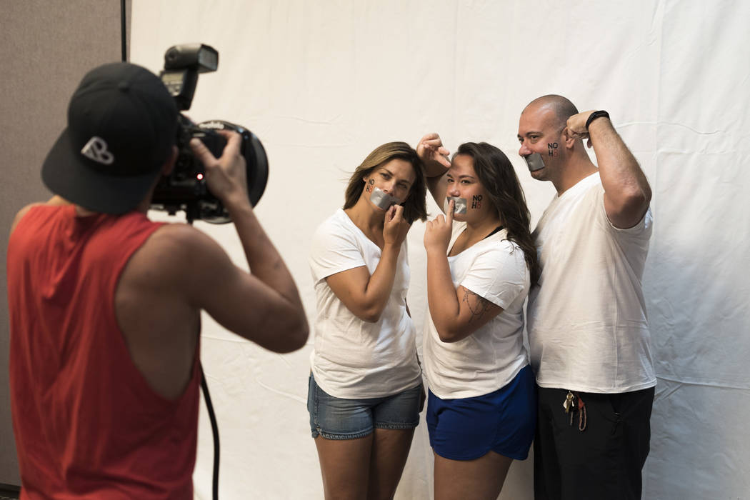 Jenny Scarale, left, mother, Isabella Scarale, middle, daughter, and Jason Scarale, right, father, participate in the NO H8 campaign photoshoot at The Gay and Lesbian Community Center of Southern ...