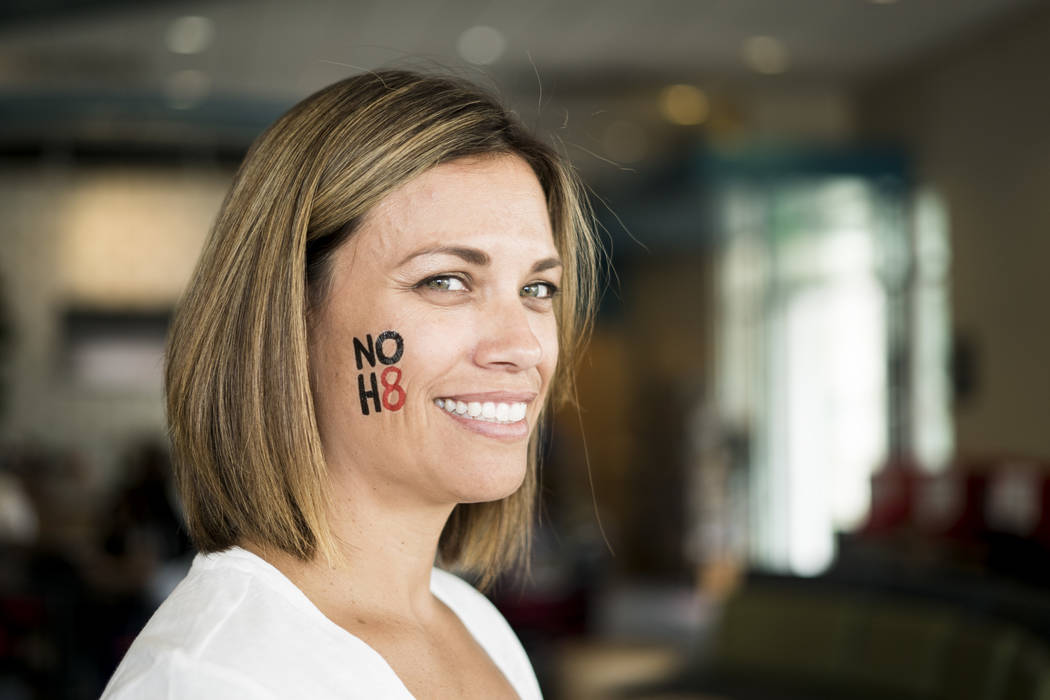 Jenny Scarale participates in the NO H8 campaign photoshoot at The Gay and Lesbian Community Center of Southern Nevada in Las Vegas, Saturday, July 7, 2018. NO H8 is a worldwide photographic silen ...