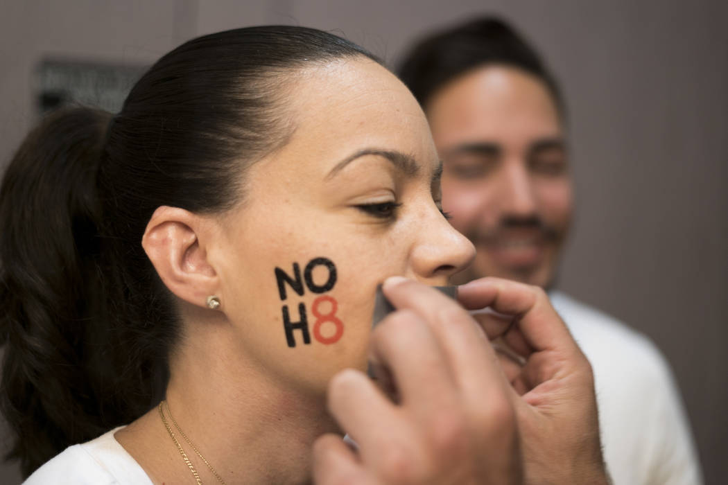 Geysy Fernandez has duct tape place over her mouth for the NO H8 campaign photoshoot at The Gay and Lesbian Community Center of Southern Nevada in Las Vegas, Saturday, July 7, 2018. NO H8 is a wor ...
