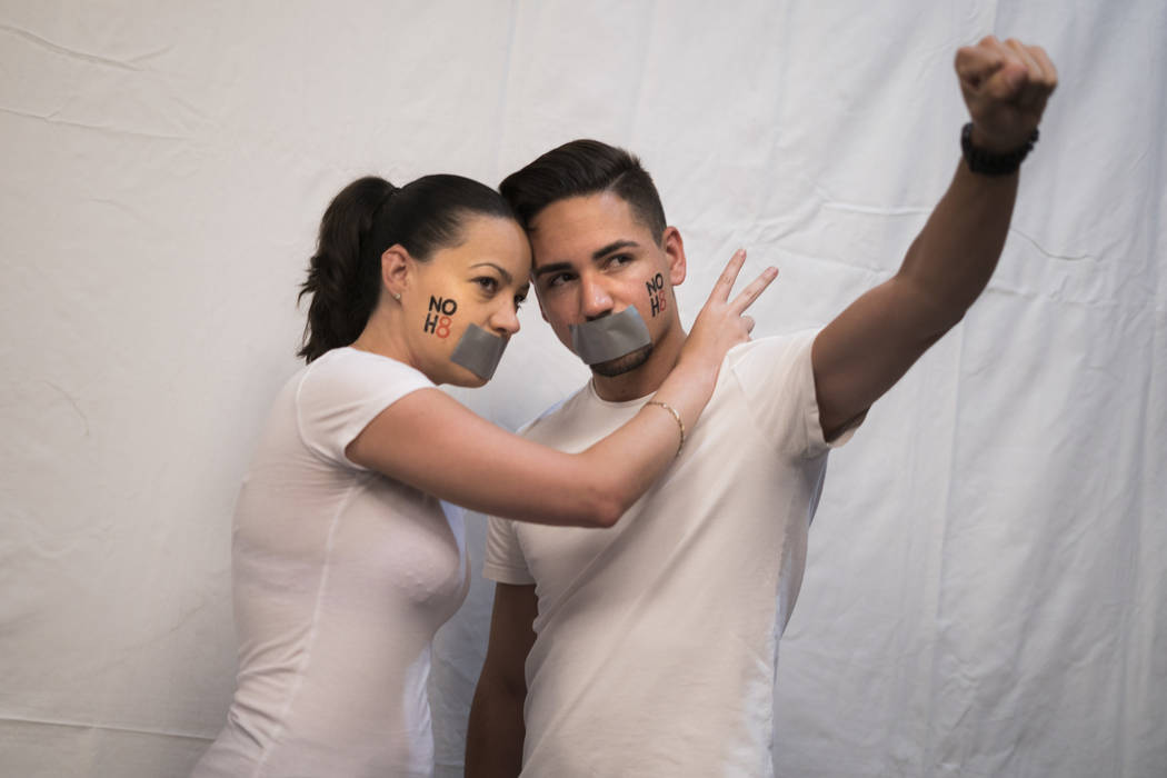 Geysy Fernandez, left, and her brother Kaylee Fernandez, right, pose for the NO H8 campaign photoshoot at The Gay and Lesbian Community Center of Southern Nevada in Las Vegas, Saturday, July 7, 20 ...