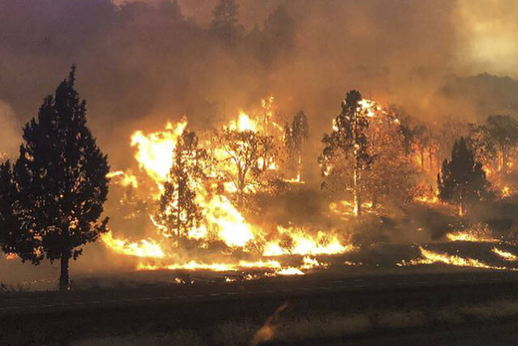 The Klamathon Fire burns in Hornbrook, Calif., on Friday, July 6, 2018. (California Highway Patrol via AP)