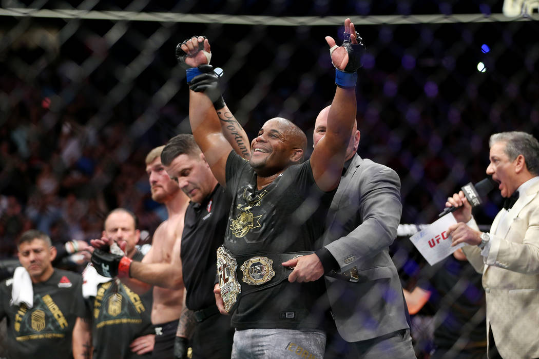 Daniel Cormier celebrates his knockout win against Stipe Miocic in the first round of the heavyweight title bout during UFC 226 at T-Mobile Arena in Las Vegas, Saturday, July 7, 2018. Erik Verduzc ...