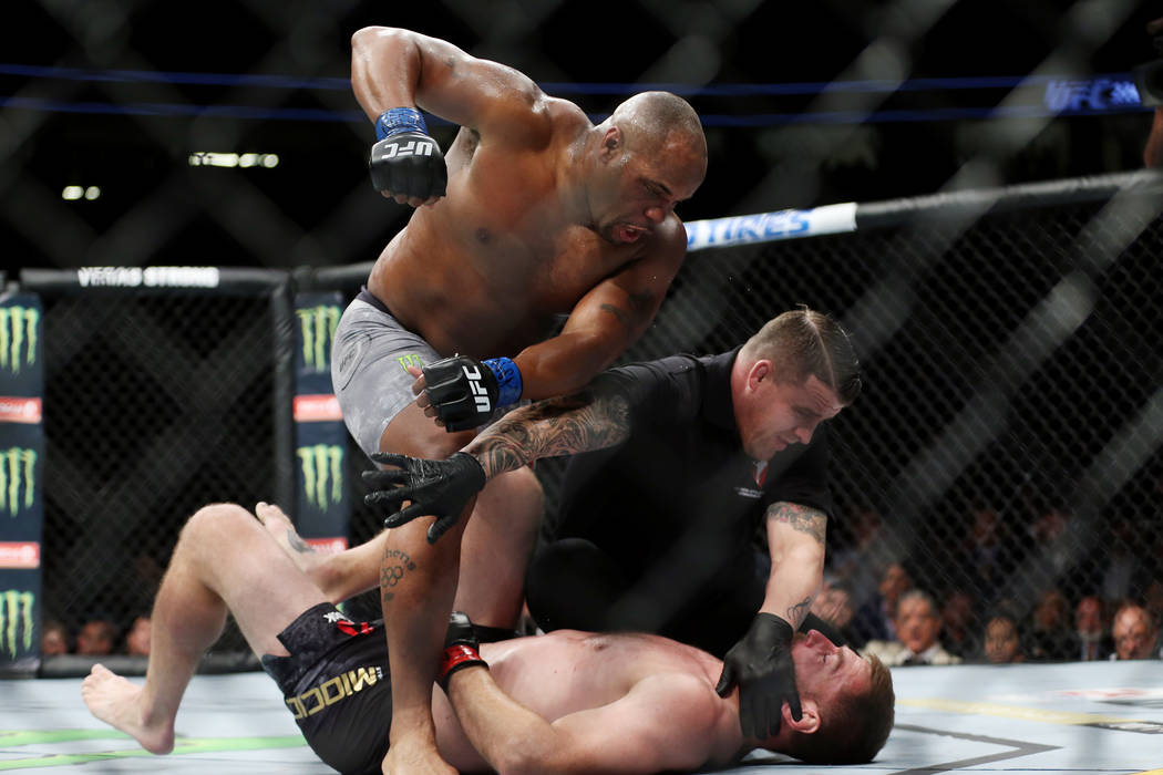 Daniel Cormier knocks out Stipe Miocic in the first round of the heavyweight title bout during UFC 226 at T-Mobile Arena in Las Vegas, Saturday, July 7, 2018. Cormier won by knockout. Erik Verduzc ...