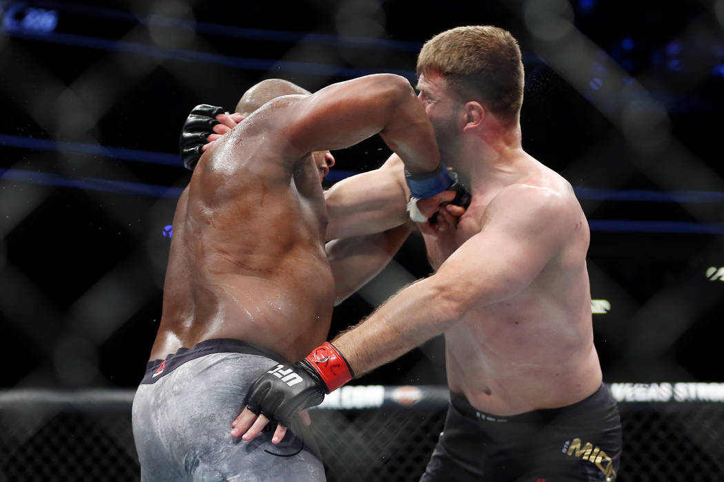 Daniel Cormier connects a punch against Stipe Miocic to knock him out in the first round of the heavyweight title bout during UFC 226 at T-Mobile Arena in Las Vegas, Saturday, July 7, 2018. Cormie ...