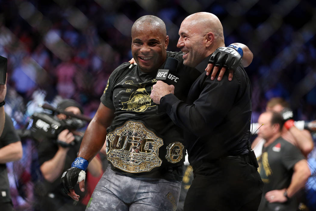 Daniel Cormier, left, with UFC commentator Joe Rogan, celebrates his knockout win against Stipe Miocic in the heavyweight title bout during UFC 226 at T-Mobile Arena in Las Vegas, Saturday, July 7 ...