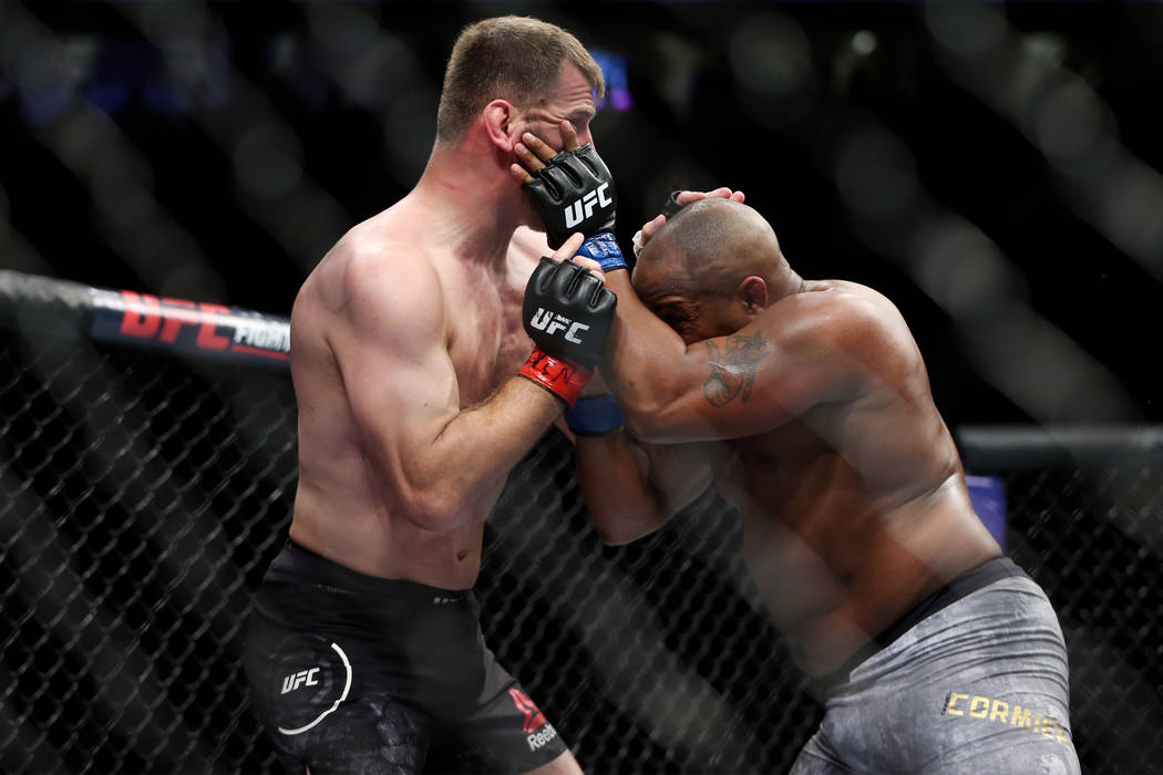 Stipe Miocic, left, battles Daniel Cormier in the heavyweight title bout during UFC 226 at T-Mobile Arena in Las Vegas, Saturday, July 7, 2018. Cormier won by way of knockout in the first round. E ...