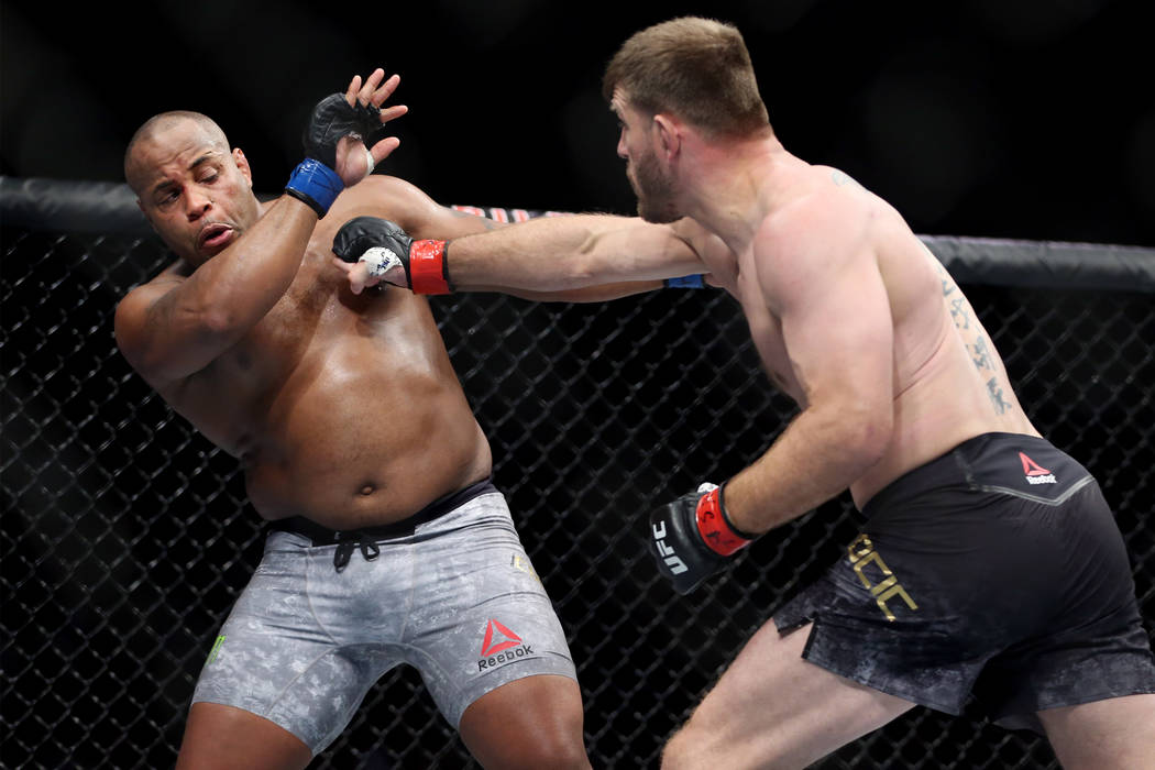 Stipe Miocic, right, battles Daniel Cormier in the heavyweight title bout during UFC 226 at T-Mobile Arena in Las Vegas, Saturday, July 7, 2018. Cormier won by way of knockout in the first round. ...