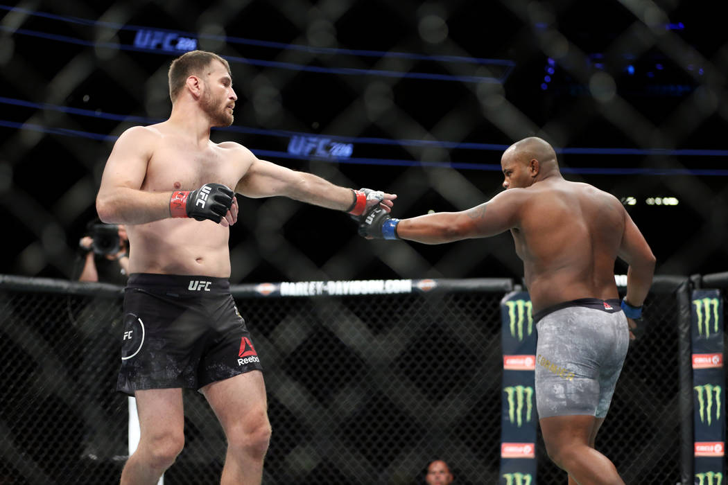 Stipe Miocic, left, and Daniel Cormier touch gloves at the beginning of the heavyweight title bout during UFC 226 at T-Mobile Arena in Las Vegas, Saturday, July 7, 2018. Cormier won by way of knoc ...