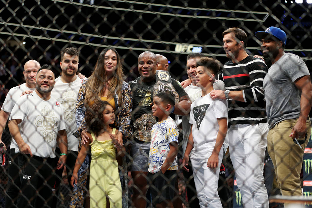 Daniel Cormier, center, with his family and friends after winning against Stipe Miocic in the heavyweight title bout during UFC 226 at T-Mobile Arena in Las Vegas, Saturday, July 7, 2018. Cormier ...