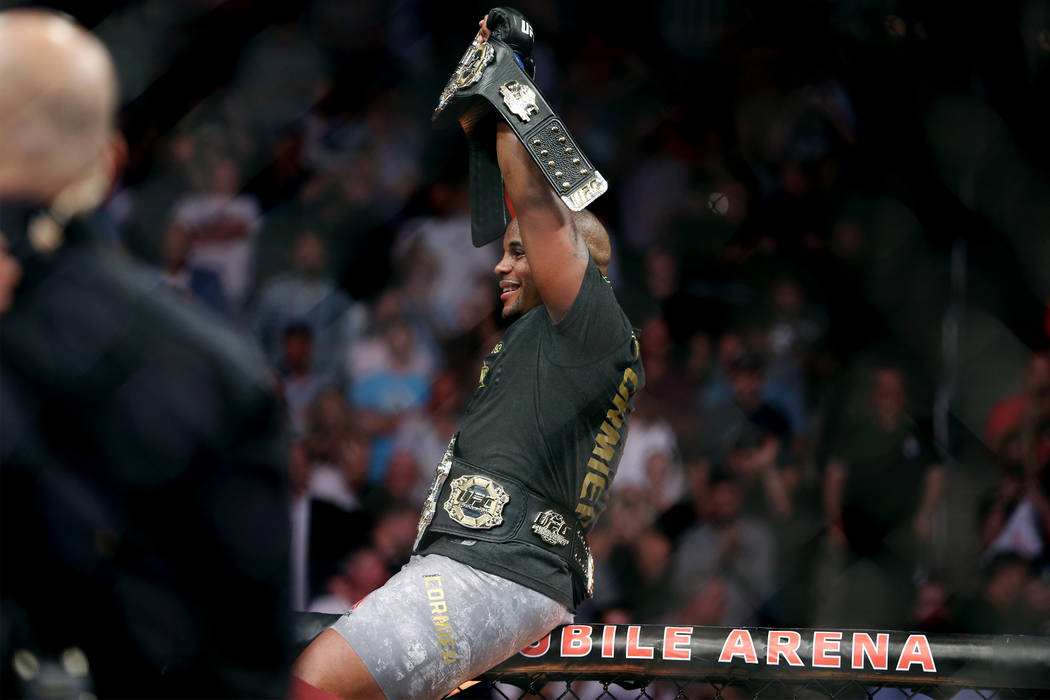 Daniel Cormier celebrates his knockout win against Stipe Miocic in the heavyweight title bout during UFC 226 at T-Mobile Arena in Las Vegas, Saturday, July 7, 2018. Erik Verduzco Las Vegas Review- ...